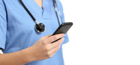 Female doctor holding phone